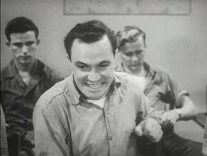 Gene Kelly, as a troubled seaman, expressing anxiety.
