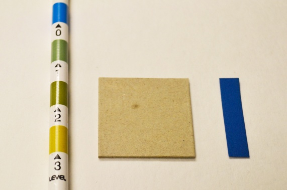 A board sample, colored test strip and color chart for comparison.