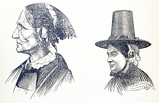 A thin severe looking woman and a round faced amiable looking woman.