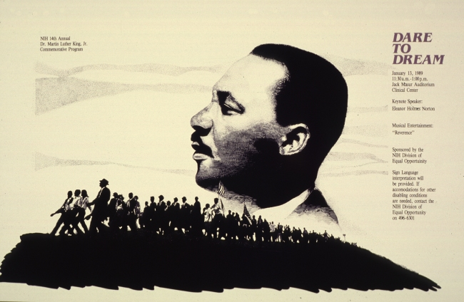 The profile of Dr. Martin Luther King, Jr. looms large in the sky as people are marching on the ground.