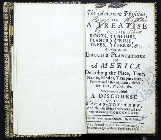 The title page of an open book with a gold embossed cover.