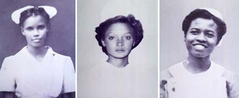 Three black women in nurse's uniforms.