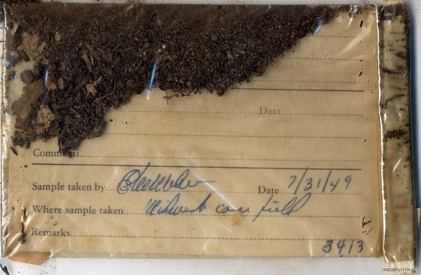 A clear plastic bag containing a soil sample and card dated 7/31/49.