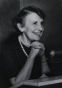 Anna Freud smiles from a podium.