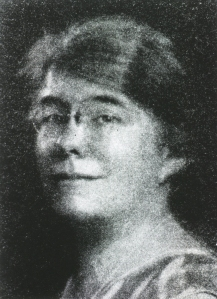 half tone portrait image of Emily Dunning Barringer in glasses.
