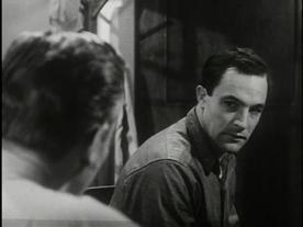 Gene Kelly as Seaman Bob Lucas, upset, talking to the miltary psychiatrist.