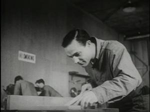 Gene Kelly as Seaman Bob Lucas woodworking as occupational therapy.