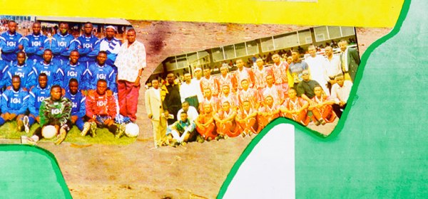 Detail of a poster showing photographs of soccer teams.