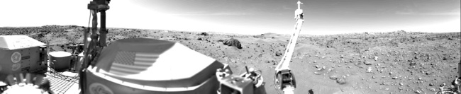 The rocky landscape of Mars with part of the Viking 1 lander in the foreground.