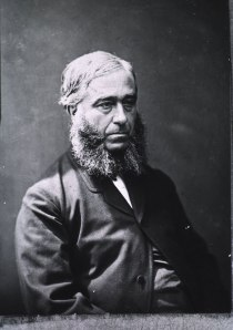 Formal photographic portrait of a man.