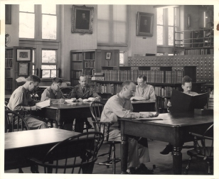 Photograph of medical men using the library reading room