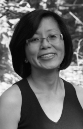 Portrait of Aline Lin, outdoors.