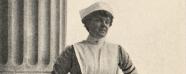 Mary Dexter in a nurses uniform posing in a columned portico.