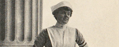 Mary Dexter in a nurses uniform posing in a columned portico.