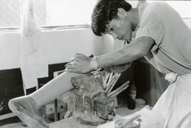 A man works on a prosthetic.