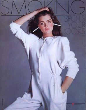Brooke Shields with cigarettes stuck in her ears.