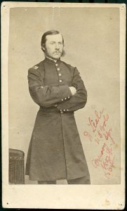 A man in uniform standing for a portrait.
