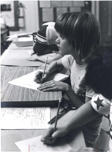 Three children write or draw with pencils in a classroom like setting.