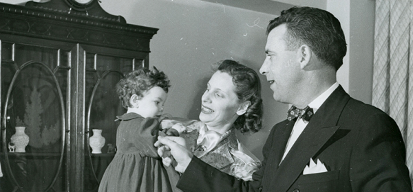 John E. Fogarty at home with his wife Luise and daughter Mary, 1948 or 1949