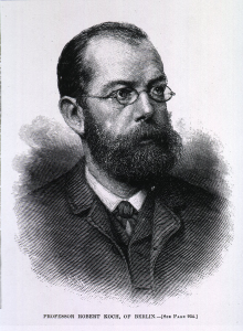 Engraving of Koch in a suit, beard and glasses.