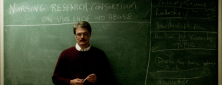 A candid photo of Dan Shridan in front of a chalkboard.