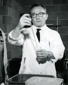 Sol Spiegelman in lab with pipette, ca. 1965 Courtesy of the University of Illinois at Urbana-Champaign Archives