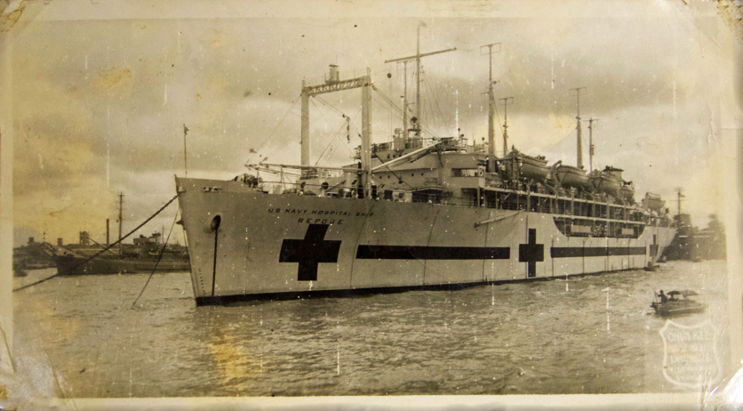 A large ship painted with red crosses