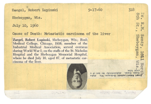 A typed index card with a photo and printed obituary pated to it.
