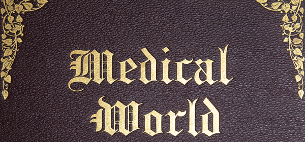 A detail of the title on the gold tooled cover of the book Medical World.