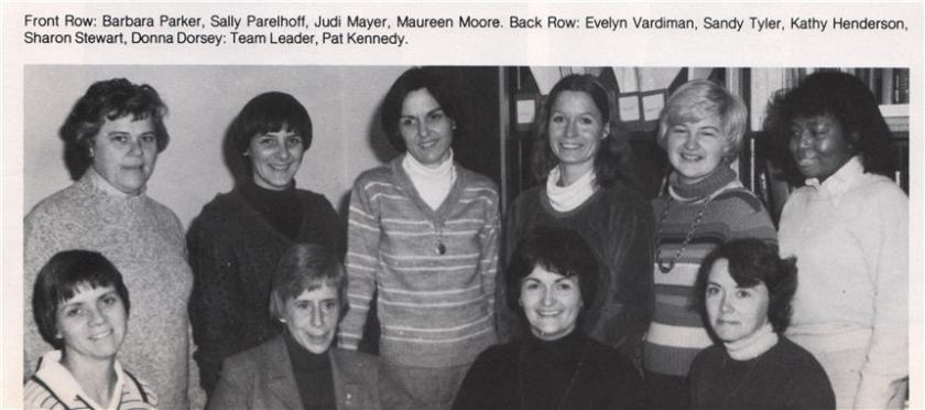 A newspaper or newsletter clipping of a photograph of a group of women posing together.
