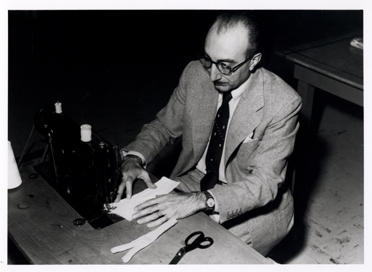 Michael DeBakey at home sewing a Dacron artificial artery, 1955. Reproduced with permission of the Baylor College of Medicine Archives.