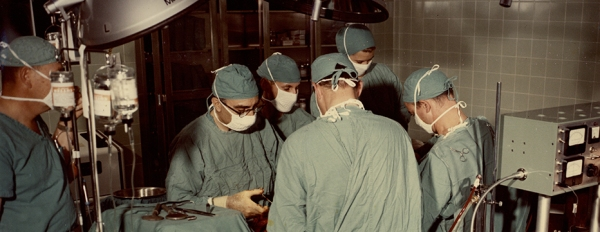 Michael DeBakey and surgical team at work in an operating room.
