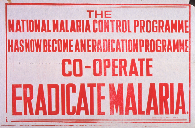 A sign reading: National Malaria Eradication Programme has now become an eradication programme co-operate eradicate malaria.