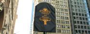 Shrouded Historical Marker prepared for ceremonial unveiling.