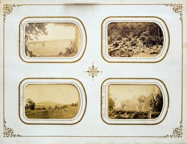 A cardboard page with decorativly framed cut outs showing photographs stored inside the page.