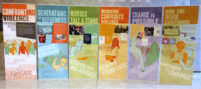 Confronting violence, six exhibition banners, installed in a lobby.
