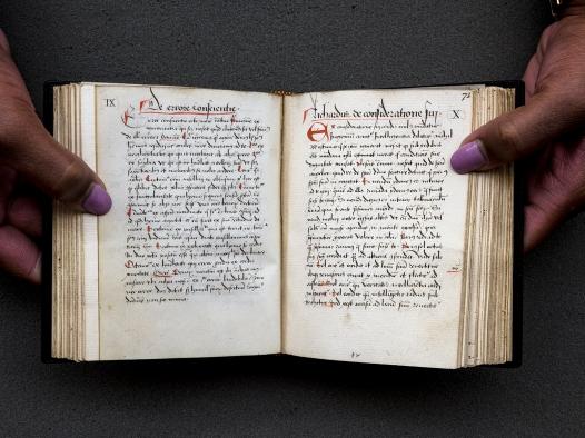 A small handwritten book held open.