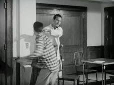 Mr. Harve reaches toward a man who leans violently away.