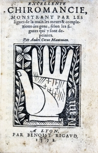 Woodcut title page with illustration of lines on the palm of a hand.