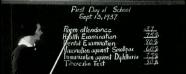 A teacher reviews a classroom's vaccination status on a blackboard.