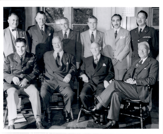 Ten men pose indoors, DeBakey stands second from the right in the rear.
