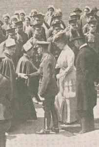 Dignitaries greet nurses and shake hands.