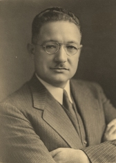 Formal portrait of Soper in a suit.
