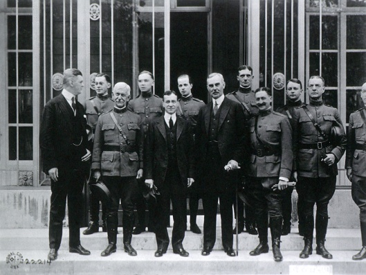 Photograph of group of men standing.