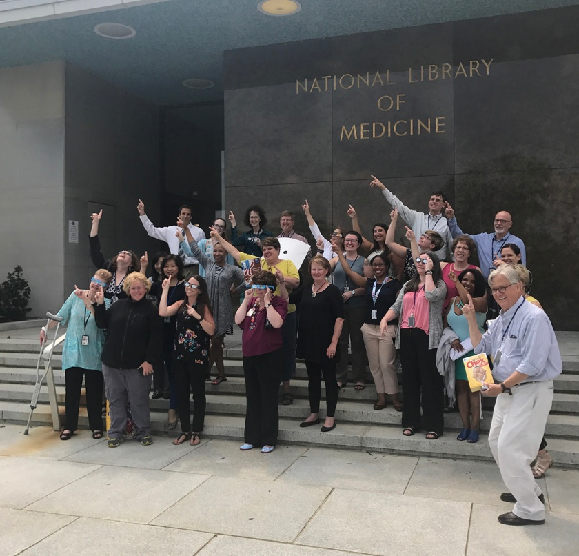 NLM staff viewing eclipse from the front steps. Photograph by Allison Fisher