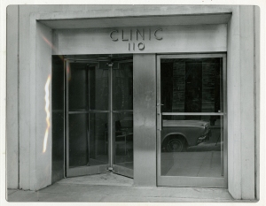 An entrance with a revolving door labeled clinic.