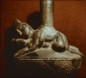 A tomb pottery piece depicting a sexual activity.