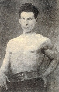 Half-tone photograph of a muscular young man posing with no shirt.