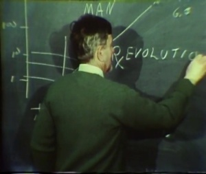 A man writes RxEvolution on a chalkboard.