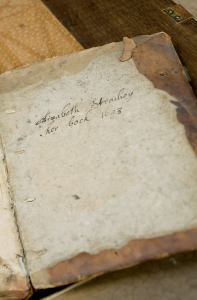 A book roughly covered in leather with a handwritten inscription reading: Elizabeth Strachey her book 1693